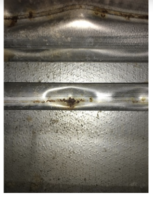heat exchanger with rust and holes